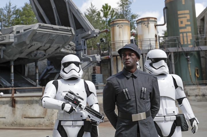 A First Order officer, center, and two storm troopers on patrol during a preview of the Star Wars themed land, Galaxy's Edge in Hollywood Studios at Disney World, Tuesday, Aug. 27, 2019, in Lake Buena Vista, Fla. The attraction will open Thursday to park guests. (AP Photo/John Raoux)