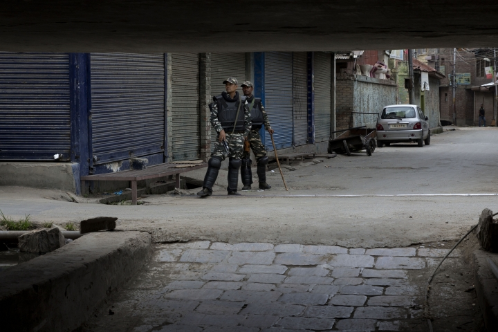 Indian paramilitary soldiers stand guard at a closed market in central Srinagar, Indian controlled Kashmir, Tuesday, Aug. 27, 2019. Earlier this month, the Indian government revoked Muslim-majority Kashmir's decades-old special status guaranteed under India's constitution. The government followed the move with an intense crackdown including a media blackout and backed by thousands of troops. (AP Photo/Dar Yasin)