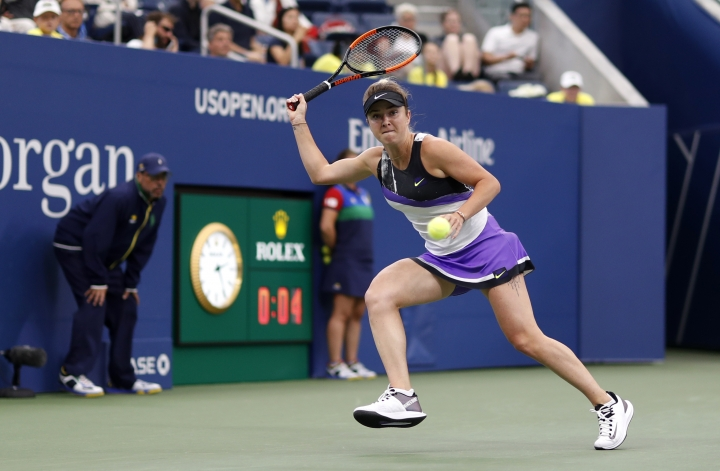 Elina Svitolina, of Ukraine, returns a shot to Venus Williams, of the United States, during the second round of the US Open tennis championships Wednesday, Aug. 28, 2019, in New York. (AP Photo/Michael Owens)