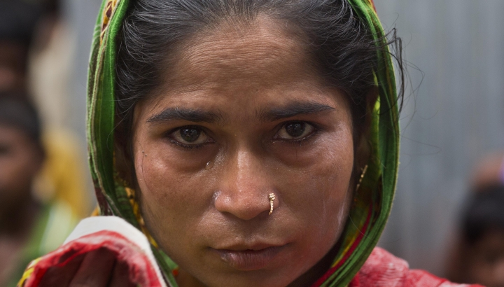 In this Aug. 28, 2019, photo, Halimun Nessa, 32, wife of Rahim Ali, who committed suicide the day before his children were to appear in front of a National Register of Citizens tribunal, wipes her tears standing outside her house in Barpeta, in India's northeastern state of Assam. Nessa said that her husband was worried their children would be excluded from a government citizenship list. India on Saturday, Aug. 31 plans to publish a controversial citizenship list that advocates say will help rectify decades of unchecked illegal immigration into the northeastern state of Assam from Bangladesh. (AP Photo/Anupam Nath)