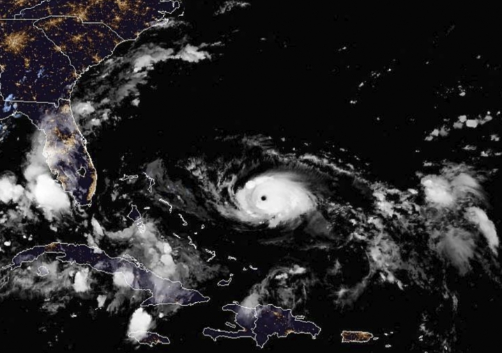 This photo provided by the National Oceanic and Atmospheric Administration shows a satellite view of Hurricane Dorian taken at 10:00 p.m. EDT, Friday, Aug. 30, 2019. (NOAA via AP)