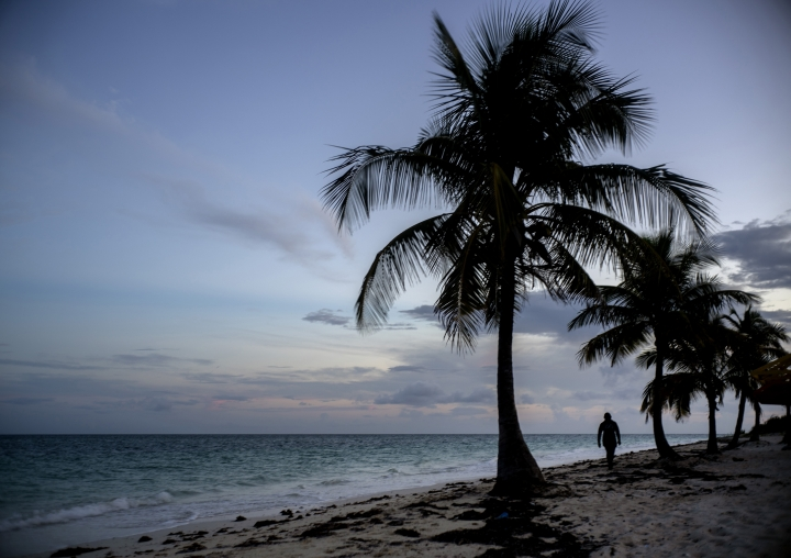 A woman walks along a beach before the arrival of Hurricane Dorian in Freeport, Grand Bahama, Bahamas, Saturday Aug. 31, 2019. Hurricane Dorian is closing in on the northern Bahamas, threatening to batter the normally idyllic islands with fierce winds, pounding waves and torrential rain. (AP Photo/Ramon Espinosa)