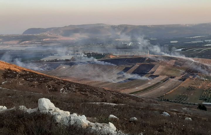 Smoke rises from Israeli army shells that landed in the southern Lebanese border village of Maroun Al-Ras, Lebanon, Sunday, Sept. 1, 2019. The Lebanese army says Israeli forces have fired some 40 shells on the outskirts of several border villages following an attack by the militant Hezbollah group on Israeli troops. (AP Photo/Mohammed Zaatari)