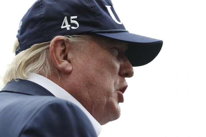 President Donald Trump speaks to the media as he returns to the White House from Camp David, Sunday, Sept. 1, 2019, in Washington. (AP Photo/Jacquelyn Martin)