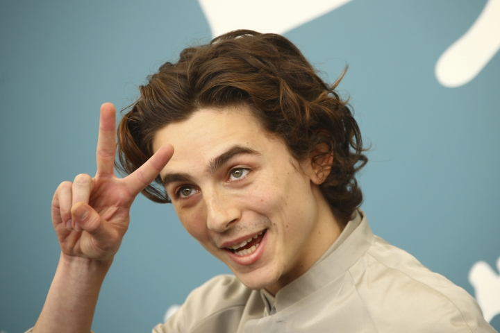 Actor Timothee Chalamet makes a peace sign as he poses for photographers at the photo call for the film 'The King' at the 76th edition of the Venice Film Festival in Venice, Italy, Monday, Sept. 2, 2019. (Photo by Joel C Ryan/Invision/AP)
