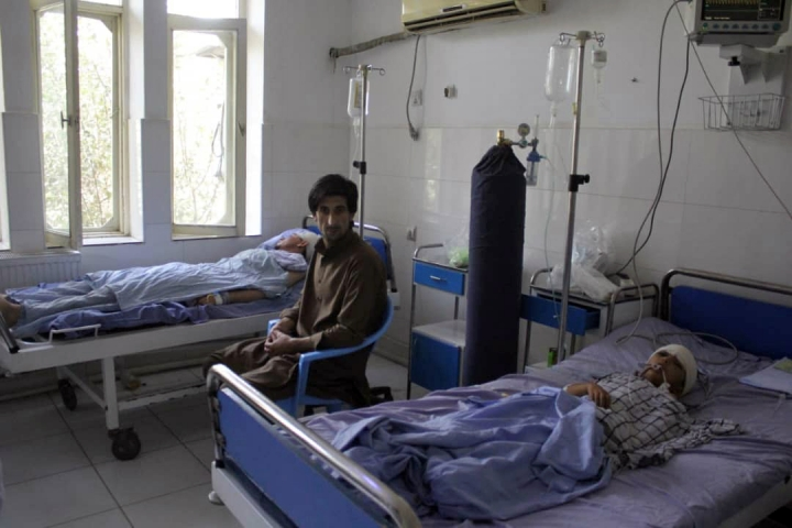 """A wounded man and a young boy receive treatment in a hospital, after a fight between Taliban and Afghan security forces in Kunduz province on Saturday, north of Kabul, Afghanistan, Sunday, Sept. 1, 2019. The Taliban attacked a second Afghan city in as many days on Sunday and killed several members of security forces, officials said, even as Washington's peace envoy said the U.S. and the militant group are """"at the threshold of an agreement"""" to end America's longest war. (AP Photo/Bashir Khan Safi)"""