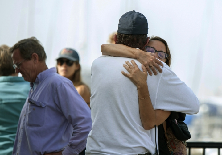 People hug each other as they await news outside of the Truth Aquatics office in Santa Barbara, Calif., on Monday, Sept. 2, 2019. Multiple people are feared dead after a dive boat caught fire before dawn Monday off the Southern California coast, according to the Coast Guard. (AP Photo/Christian Monterrosa)