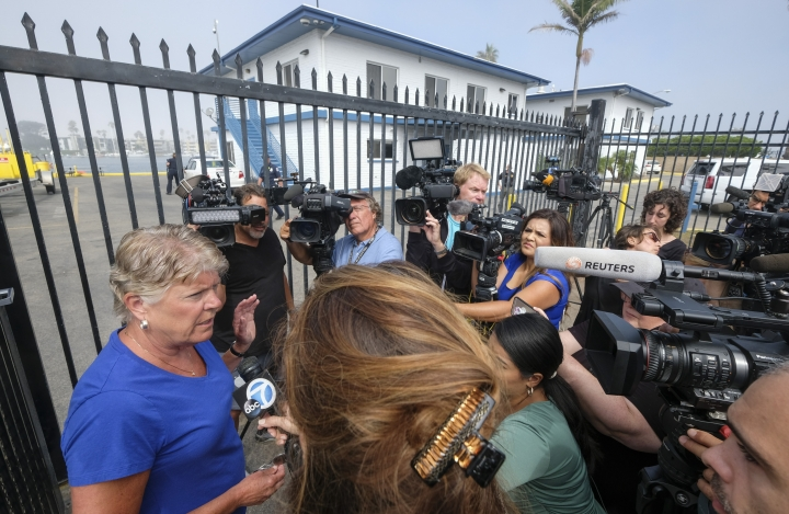 Congresswoman Julia Broenley talks to media at outside of the U.S. Coast Guard Station Channel Islands in Oxnard, Calif., Monday, Sept. 2, 2019. (AP Photo/Ringo H.W. Chiu)