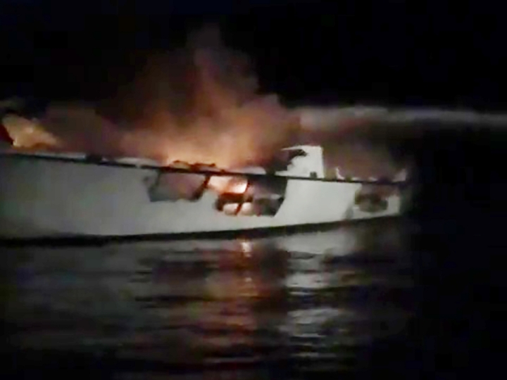 "This image made from video released by TowBoatUS Ventura shows a burning out charter dive boat ""Conception,"" before it sank off Santa Cruz Island, near the coast of Ventura County, Calif., early Monday, Sept. 2, 2019. (Capt. Paul Amaral/TowBoatUS Ventura via AP)"