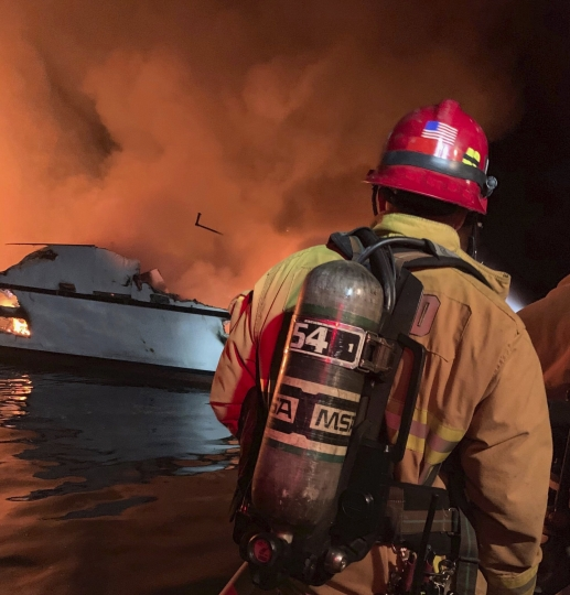 "In this photo provided by the Ventura County Fire Department, VCFD firefighters respond to a boat fire off the coast of southern California, Monday, Sept. 2, 2019. The U.S. Coast Guard said it has launched several boats to help over two dozen people ""in distress"" off the coast of southern California. (Ventura County Fire Department via AP)"