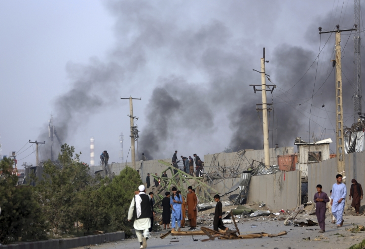 Smoke billows from the Green Village, home to several international organizations and guesthouses, in Kabul, Afghanistan, Tuesday, Sept. 3, 2019. Angry residents climbed into the international compound that had been targeted and set part of it on fire. (AP Photo/Rahmat Gul)