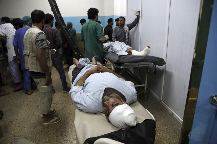 Wounded men receive treatment in a hospital, after a large explosion in Kabul, Afghanistan, Monday, Sept. 2, 2019. The Taliban claimed responsibility for a large explosion in the Afghan capital Monday night, which government officials said targeted an area home to several international organizations and guesthouses. (AP Photo/Rahmat Gul)