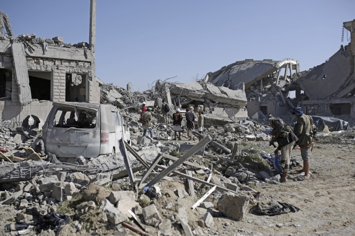 People inspect the rubble at a Houthi detention center destroyed by Saudi-led airstrikes, that killed at least 60 people and wounding several dozen according to officials and the rebels' health ministry, in Dhamar province, southwestern Yemen, Sunday, Sept. 1, 2019. The officials said the airstrikes took place Sunday and targeted a college in the city of Dhamar, which the Houthi rebels use as a detention center. The Saudi-led coalition said it had hit a Houthi military facility used as storages for drones and missiles in Dhamar. (AP Photo/Hani Mohammed)