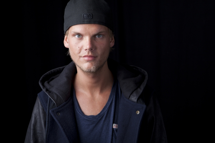 FILE - In this Aug. 30, 2013 file photo, Swedish DJ, remixer and record producer Avicii poses for a portrait, in New York. A benefit concert for suicide prevention featuring the music of the late star Avicii is being planned for Dec. 5, 2019, in Stockholm, Sweden. Proceeds will support the work of the new Tim Bergling Foundation, named for the musician who killed himself in April 2018. (Photo by Amy Sussman/Invision/AP, File)