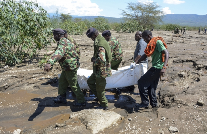 Police officers carry away a retrieved body after a flash flood in Hell's Gate national park near Naivasha, Kenya Monday, Sept. 2, 2019. Kenyan authorities have suspended visits to the gorges of the park in the Rift Valley after the flash flood, which occurred Sunday evening, killed a number of tourists and their driver. (AP Photo)