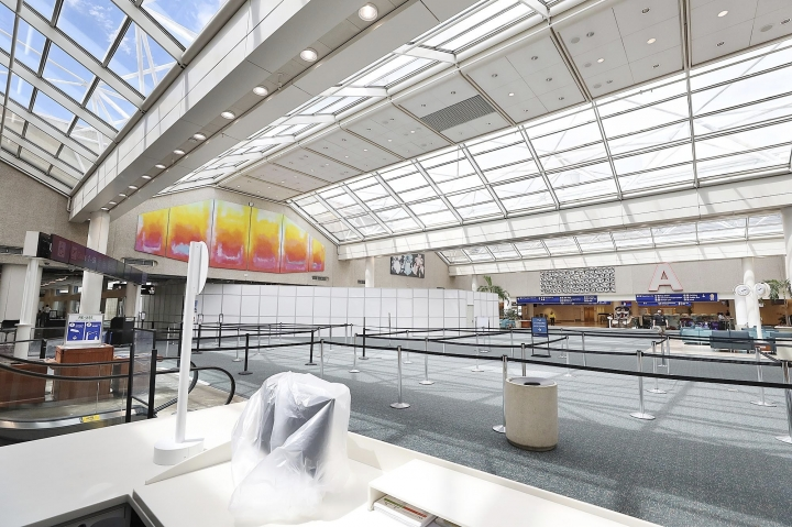 The terminal is empty as Orlando International Airport is closed on Tuesday, Sept. 3, 2019 ahead of Hurricane Dorian. (Stephen M. Dowell/Orlando Sentinel via AP)
