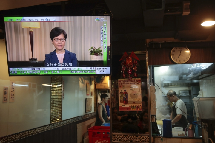 Hong Kong Chief Executive Carrie Lam makes an announcement on an extradition bill in television message, seen at a restaurant in Hong Kong, on Wednesday, Sept. 4, 2019. Hong Kong Chief Executive Lam has announced the government will formally withdraw an extradition bill that has sparked months of demonstrations in the city, bowing to one of the protesters' demands. The bill would have allowed Hong Kong residents to be sent to mainland China for trials. It sparked massive protests that have become increasingly violent and caused the airport to shut down earlier this month.(AP Photo/Jae C. Hong)