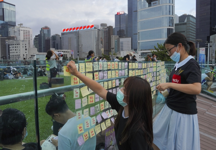 Protesters put their massage on Sticky Note Lennon Walls during continuing pro-democracy rallies in Tamar Park, Hong Kong, on Tuesday, Sept. 3, 2019. Hong Kong leader Carrie Lam said Tuesday she has never tendered her resignation to China over the anti-government protests that have roiled the city for three months. (AP Photo/Vincent Yu)