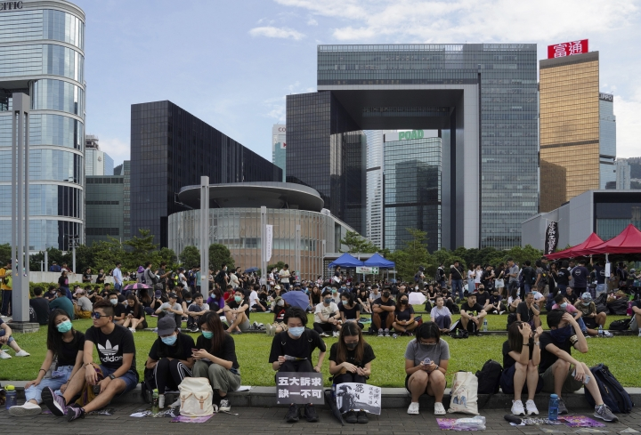 Protesters gather during a pro-democracy rally in Tamar Park, Hong Kong, on Tuesday, Sept. 3, 2019. Hong Kong leader Carrie Lam said Tuesday she has never tendered her resignation to China over the anti-government protests that have roiled the city for three months. (AP Photo/Vincent Yu)