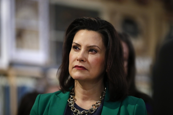 FILE - In this March 18, 2019, file photo, Michigan Gov. Gretchen Whitmer listens to Democratic presidential candidate Sen. Kirsten Gillibrand, D-N.Y., in Clawson, Mich. Whitmer is moving to make Michigan the first state to ban flavored e-cigarettes. The Democrat announced Wednesday, Sept. 4 that she ordered the state health department to issue emergency rules. They will prohibit the sale and misleading marketing of flavored nicotine vaping products. (AP Photo/Paul Sancya, File)