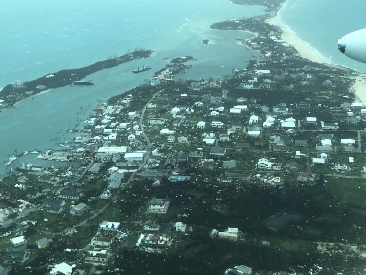 This aerial photo provided by Medic Corps, shows the destruction brought by Hurricane Dorian on Man-o-War Cay, Bahamas, Tuesday, Sept.3, 2019. Relief officials reported scenes of utter ruin in parts of the Bahamas and rushed to deal with an unfolding humanitarian crisis in the wake of Hurricane Dorian, the most powerful storm on record ever to hit the islands. (Medic Corps via AP)