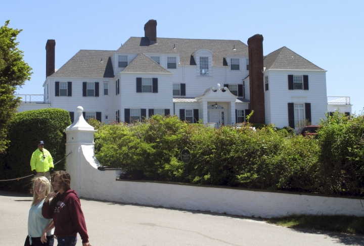 FILE - In this May 27, 2013 photo, people walk past a house owned by Taylor Swift in the village of Watch Hill in Westerly, R.I. Richard Joseph McEwan, of Milford, N.J., was arrested on Friday, Aug. 30, 2019, and charged with breaking into Swift's Westerly, R.I., oceanfront house. (AP Photo/Dave Collins, File)
