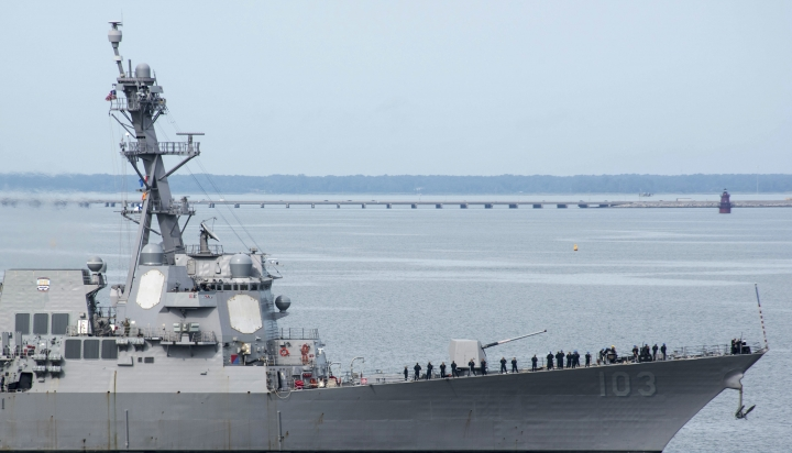 This image provided by the US Navy shows the USS Truxtun (DDG-103) an Arleigh Burke-class destroyer as it heads out of the it's berth at Naval Station Norfolk ahead of Hurricane Dorian in Norfolk, Va., Wednesday Sept. 4, 2019. The U.S. Navy has ordered ships based on Virginia's coast to head out to sea to avoid Hurricane Dorian. (Alton Dunham/US Navy via AP)
