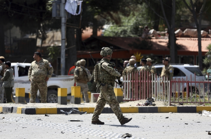 Resolute Support (RS) forces and Afghan security personnel inspect the site of a car bomb explosion in Kabul, Afghanistan, Thursday, Sept. 5, 2019. A car bomb rocked the Afghan capital on Thursday and smoke rose from a part of eastern Kabul near a neighborhood housing the U.S. Embassy, the NATO Resolute Support mission and other diplomatic missions. (AP Photo/Rahmat Gul)