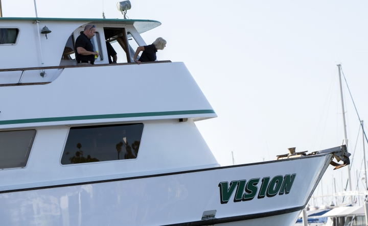 National Transportation Safety Board member Jennifer Homendy, right, and Investigator In Charge Adam Tucker inspect the Vision, aa sister vessel to the dive boat Conception, at Santa Barbara Harbor on Wednesday, Sept. 4, 2019 in Santa Barbara, Calif. A fire raged through a boat carrying recreational scuba divers anchored near an island off the Southern California Coast on Monday, Sept. 2, leaving multiple people dead. (AP Photo/Christian Monterrosa )