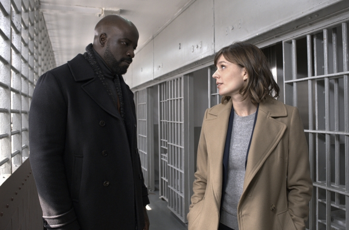 "This image released by CBS shows Mike Colter, left, and Katja Herbers in a scene from ""Evil,"" premiering Sept. 26 on CBS. (Jeff Neumann/CBS via AP)"