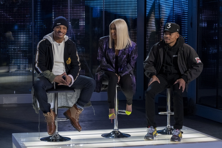 "This image released by Netflix shows, from left, rappers T.I., Cardi B and Chance the Rapper from the competition series, ""Rhythm + Flow."" (Adam Rose/Netflix via AP)"
