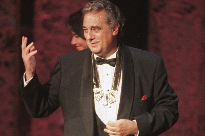 "FILE - In this Tuesday, Sept. 14, 1999 file photo, Placido Domingo acknowledges the audience after receiving the 1999 Hispanic Heritage Award at the John F. Kennedy Center for the Performing Arts in Washington. An evening before a performance of ""Le Cid,"" part of the Washington Opera's 1999-2000 season, opera singer Angela Turner Wilson said she and Domingo were having their makeup done together when he rose from his chair, stood behind her and put his hands on her shoulders. As she looked at him in the mirror, he suddenly slipped his hands under her bra straps, she said, then reached down into her robe and grabbed her bare breast. ""It hurt,"" she told The Associated Press. ""It was not gentle. He groped me hard."" She said Domingo then turned and walked away, leaving her stunned and humiliated. (AP Photo/Leslie Kossoff)"