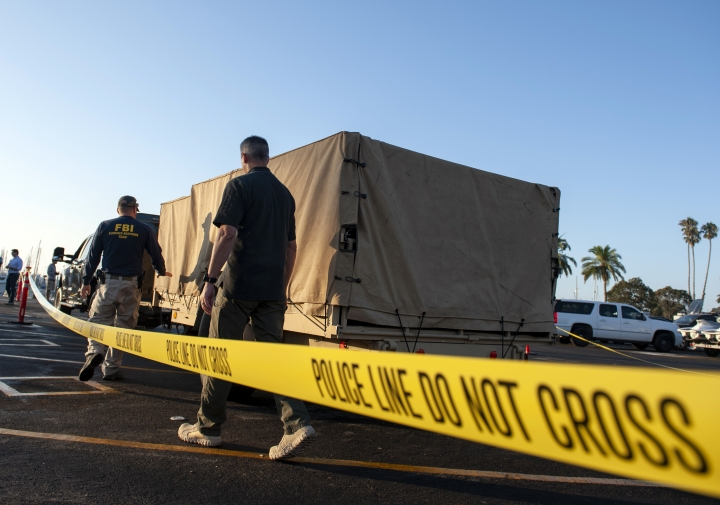 FBI investigators unload equipment to begin examining evidence obtained from the wreckage of the dive boat Conception on Wednesday, Sept. 4, 2019, in Santa Barbara, Calif. A fire raged through the boat carrying recreational scuba divers anchored near an island off the Southern California Coast on Monday, Sept. 2, leaving multiple people dead. (AP Photo/Christian Monterrosa)