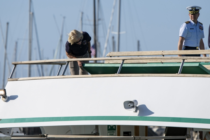 National Transportation Safety Board Board member Jennifer Homendy, left, and Jason Neubauer of the U.S. Coast Guard inspect the Vision, a sister vessel to the dive boat Conception at Santa Barbara Harbor on Wednesday, Sept. 4, 2019 in Santa Barbara, Calif. A fire raged through a boat carrying recreational scuba divers anchored near an island off the Southern California Coast on Monday, Sept. 2, leaving multiple people dead. (AP Photo/Christian Monterrosa )