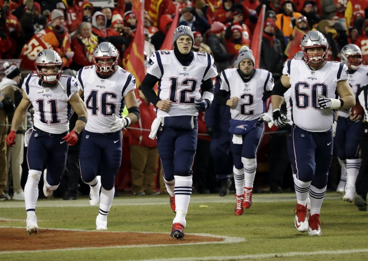 FILE - In this Jan. 20, 2019, file photo, New England Patriots quarterback Tom Brady (12) leads the team onto the field for the AFC championship NFL football game against the Kansas City Chiefs in Kansas City, Mo. The Patriots have been playing down the fact they weren't chosen for the opener of the NFL's 100th season despite their latest Lombardi Trophy. But their coaching staff finds little items to push the players' buttons, and Brady is as strong a motivator to teammates as anyone in the league. The Patriots play the Pittsburgh Steelers in Foxborough this week. (AP Photo/Elise Amendola, File)