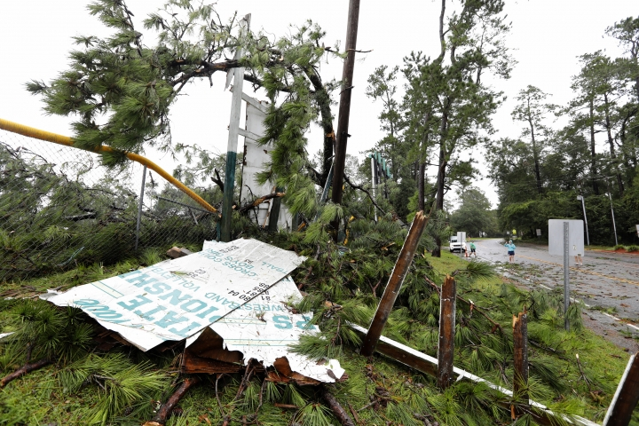 Debris covers the ground including damage to Summerville High School's football stadium's goal post and signage after Hurricane Dorian passed by Thursday, Sept. 5, 2019, in Summerville, S.C. Dorian raked the Carolina coast with howling, window-rattling winds and sideways rain Thursday, spinning off tornadoes and knocking out power to more than 200,000 homes and businesses as it pushed northward toward the dangerously exposed Outer Banks. (AP Photo/Mic Smith)