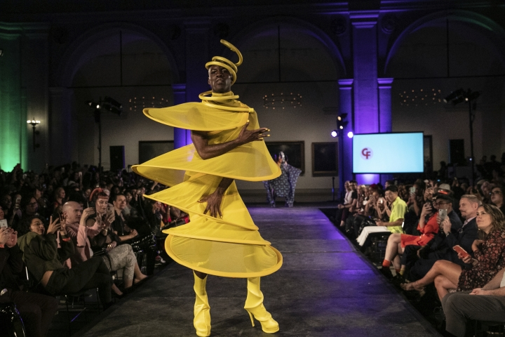 The Claire Fleury collection is modeled during the dapperQ fashion show at the Brooklyn Museum on Thursday Sept. 5, 2019, in New York. (AP Photo/Jeenah Moon)