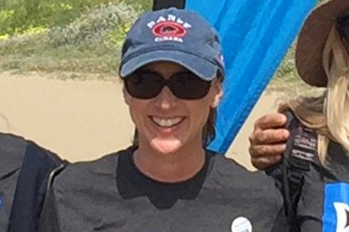 This 2017 photo provided by Heal The Bay shows Marybeth Guiney during a Heal The Bay beach cleanup project at Will Rogers State Beach in the Pacific Palisades area of Los Angeles. Guiney was among the 34 people who died aboard the dive boat Conception near Santa Cruz Island on Sept. 2, 2019. (Heal The Bay via AP)