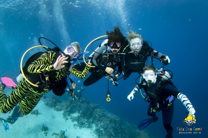This November 2018 photo provided by Margo Peyton shows, from left, Diana Ademic, Berenice Felipa, Steve Salika and Tia Salika enjoying a dive during their 2018 Thanksgiving vacation trip at a Kids Sea Camp week at Buddy Dive Resort off Bonaire, a Netherlands-administered island in the Leeward Antilles off the coast of Venezuela. All four were aboard the dive boat Conception and all died in the fire that swept the vessel on Sept. 2, 2019 off the coast of Southern California. (Margo Peyton via AP)
