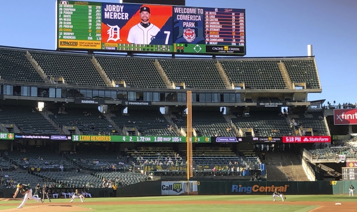 The scoreboard at the Oakland-Alameda County Coliseum welcomes fans to Comerica Park for the continuation of a game suspended by rain earlier in the season, between the Detroit Tigers and the Oakland Athletics on Friday, Sept. 6, 2019, in Oakland, Calif. (AP Photo/Ben Margot)