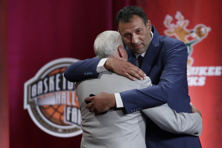 Inductee Vlade Divac, right, hugs his presenter, Jerry West, during the Basketball Hall of Fame enshrinement ceremony Friday, Sept. 6, 2019, in Springfield, Mass. (AP Photo/Elise Amendola)