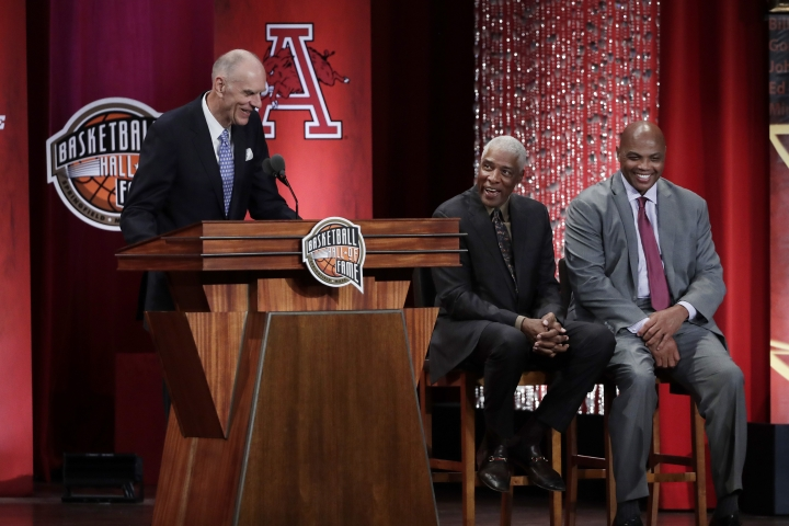 Inductee Bobby Jones speaks as his presenters, Julius Erving, middle, and Charles Barkley, laugh during the Basketball Hall of Fame enshrinement ceremony Friday, Sept. 6, 2019, in Springfield, Mass. (AP Photo/Elise Amendola)