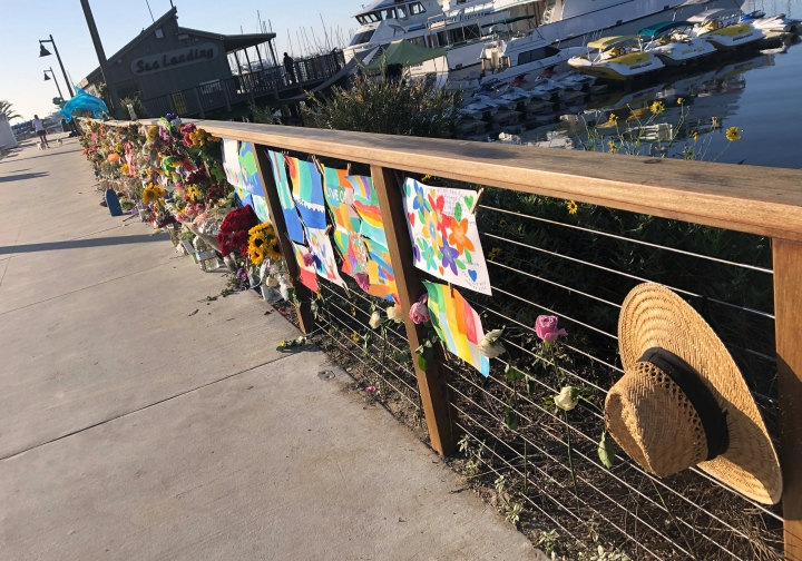 A growing memorial to those who died aboard the dive boat Conception is seen early Friday morning, Sept. 6, 2019 at the harbor in Santa Barbara, Calif. The Sept. 2 fire took the lives of 34 people on the ship off Santa Cruz Island off the Southern California coast near Santa Barbara (AP Photo/Stefanie Dazio)