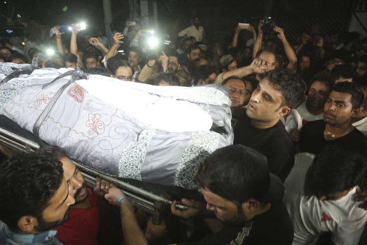 People carry the body of former Pakistani cricketer Abdul Qadir in Lahore, Pakistan, Friday, Sept. 6, 2019. Qadir who was widely regarded as one of the greatest legspinners in history, died of a cardiac arrest on Friday. He was 63. (AP Photo/K.M. Chaudary)
