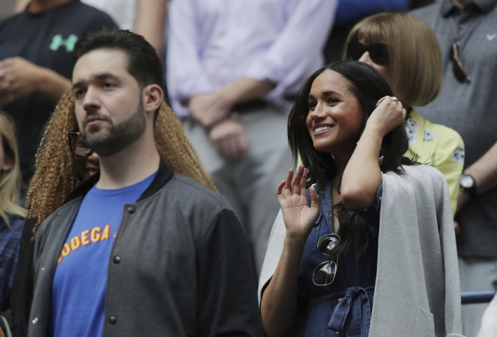 Meghan, Duchess of Sussex, right, and Alexis Ohanian, left, wait for the start of the women's singles final of the U.S. Open tennis championships between Serena Williams, of the United States, and Bianca Andreescu, of Canada, Saturday, Sept. 7, 2019, in New York. (AP Photo/Charles Krupa)