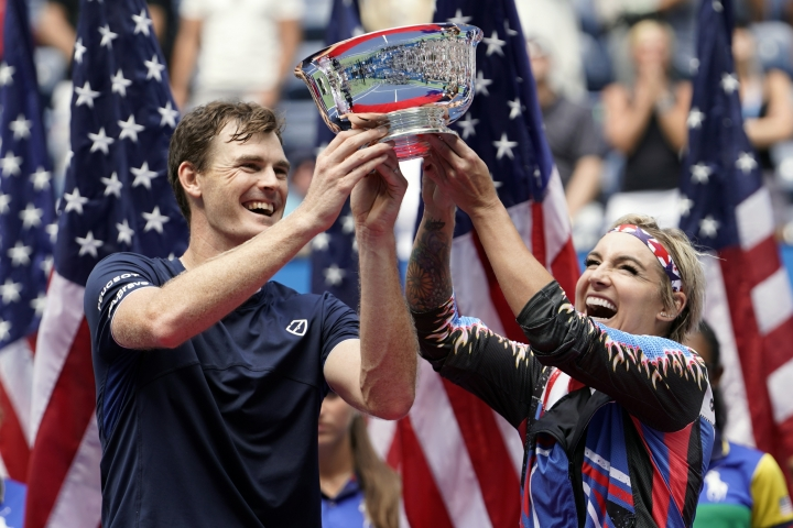 Jamie Murray, of the United Kingdom, left, and Bethanie Mattek-Sands, of the United States, hold up the championship trophy after winning the mixed doubles final against Hao-Ching Chan, of Taiwan, and Michael Venus, of New Zealand, at the U.S. Open tennis championships Saturday, Sept. 7, 2019, in New York. (AP Photo/Eduardo Munoz Alvarez)