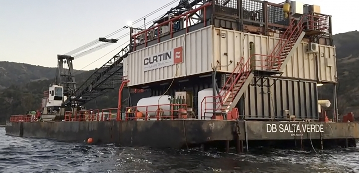 This Wednesday, Sept. 4, 2019 still image taken from video and provided by the U.S. Coast Guard shows the derrick barge Salta Verde, as it arrives as part of the salvage operation for the Conception, off the coast of Santa Cruz Island. Dive teams from the Unified Command continued recovery efforts for the last missing person from the dive boat Conception Thursday, Sept. 5, 2019. Crews are utilizing a wide range of equipment including Remote Operated Vessels and side-scan sonar to assist with search efforts. (Petty Officer 1st Class Patrick Kelley/U.S. Coast Guard via AP)