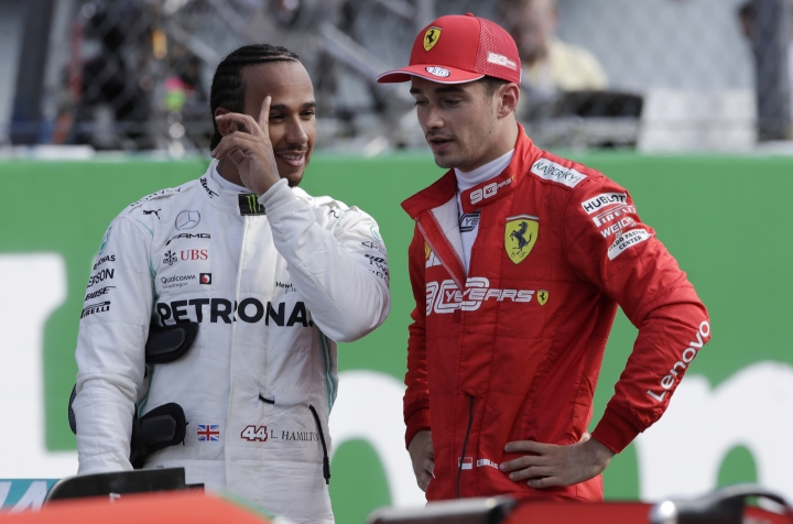 Ferrari driver Charles Leclerc of Monaco, right, talks with Mercedes driver Lewis Hamilton of Britain after the qualifying session at the Monza racetrack, in Monza, Italy, Saturday, Sept. 7, 2019. The Formula one race will be held on Sunday. (AP Photo/Luca Bruno)
