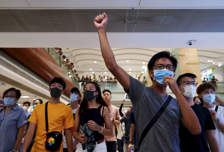 Protesters shout slogans at a shopping mall in Hong Kong, Saturday, Sept. 7, 2019. Hong Kong authorities were limiting airport transport services and controlling access to terminals Saturday as they braced for the second weekend of disruption following overnight demonstrations that turned violent. (AP Photo/Vincent Yu)