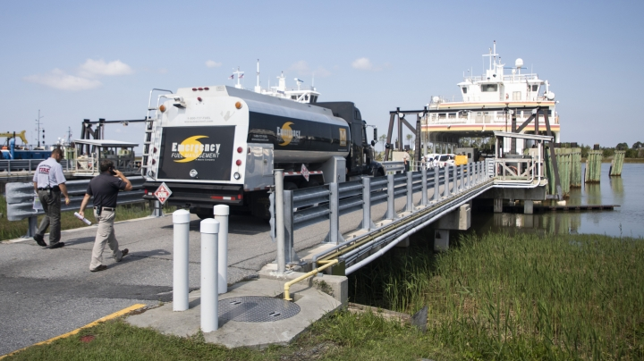 A fuel truck boards the Swan Quarter Ferry in Swan Quarter, N.C. with other emergency response vehicles, generators and supplies headed to Ocracoke on Saturday, Sept. 7, 2019. Officials in North Carolina say search-and-rescue teams are going door to door to check on people who may be injured or in need of assistance after Hurricane Dorian swamped Ocracoke Island with floodwaters. (Julia Wall/The News & Observer via AP)